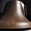 The historic Memorial Church Bell on display at the church