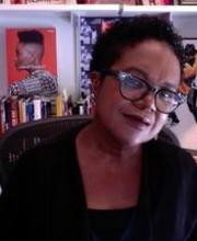 Image of Dr. Marcyliena Morgan in front of a bookshelf
