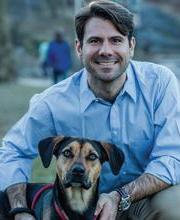 Peter Franz with his dog, Franklin.