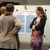 Julie Seifert discussing her poster with guests